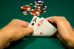 Two aces. In hand in game poker on the green casino table Royalty Free Stock Photo