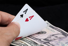Two aces and bank note Royalty Free Stock Images