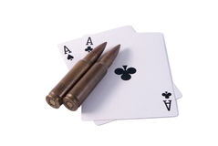 Two aces black and two rifle bullets. Isolated white right Stock Images