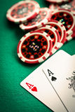 Two aces and casino chips Stock Photo