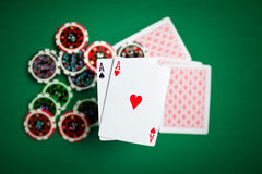 Two aces and casino chips Royalty Free Stock Photos