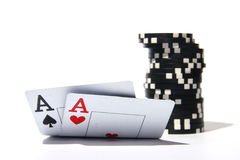 Two aces with chips Stock Photography