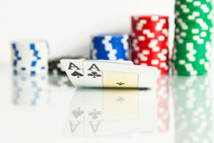 Two aces with chips Royalty Free Stock Photography