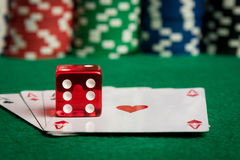 Two aces with dice and chips Royalty Free Stock Photos