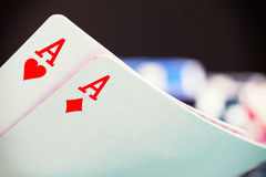 Two aces and gambling chips Stock Images