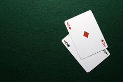 Two Aces on green felt. Close up of Ace of diamonds and spades on green felt background Royalty Free Stock Photos