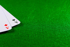 Two aces on the green felt casino table. Royalty Free Stock Photo