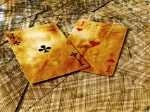 Two aces on inverted cards. Grunge gambling background. two aces on inverted cards Royalty Free Stock Photography