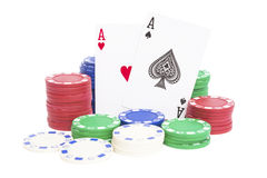 Two aces and lots of poker chips with clipping path Royalty Free Stock Photo