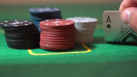 Two Aces Close Up, Poker Cards In Player Hand, Stack Of Chips On Casino Table. Two aces in male hand. Gamble player hold poker cards, open lucky combination stock footage