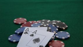 Two aces placed on a pile of poker chips. stock video footage