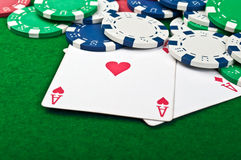 Two aces and poker chips Royalty Free Stock Image