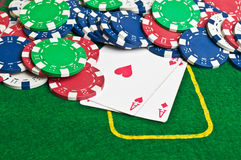 Two aces and poker chips Stock Photos