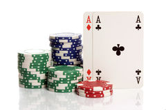 Two aces and poker chips Royalty Free Stock Photography