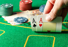 Two aces on a poker table. Royalty Free Stock Photography