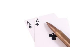 Two aces and rifle bullet right. Two aces black and rifle bullet isolated white right Stock Photo