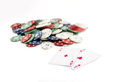 Two aces and stack of Casino Chips in background Stock Photo