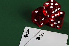 Two aces and three dices. On green background royalty free stock images