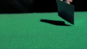 Two aces thrown in super slow motion on a table. Two aces thrown in super slow motion on a green table stock video