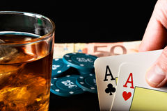 Two aces and whiskey. Royalty Free Stock Image