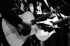 Two Acoustic Guitar Players on Stage royalty free stock image