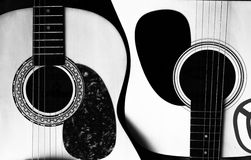 Two acoustic guitars in the form of yin-yang Royalty Free Stock Images