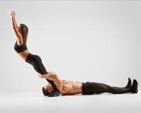 Two acrobats exercising Royalty Free Stock Photos