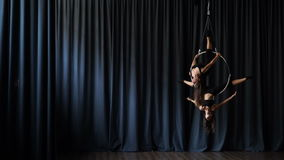 Two acrobats performs a gymnastic element on the aerial trick stock video