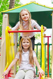 Two active girls on nursery platform Royalty Free Stock Images