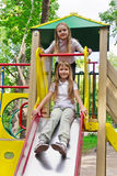 Two active girls on nursery platform Stock Images