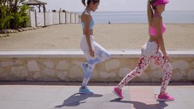 Two active healthy young women working out stock video