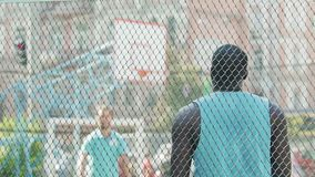 Two active men passing ball to each other, training on basketball court, slow-mo. Stock footage stock footage