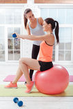 Two active women training with fitball Stock Photography