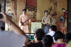 Two actors performing Chinese traditional musical instruments,  two-stringed Chinese fiddle and  four-stringed Chinese fiddle Stock Photography