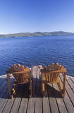 Two Adirondack chairs. On a deck overlooking Lake George, NY Royalty Free Stock Photos