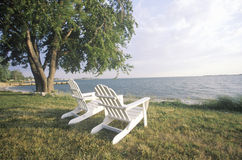 Two Adirondack chairs stock photography