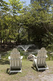 Two Adirondack chairs seen from the back Stock Photos