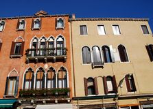 Two adjacent buildings illuminated by the sun in Venice in Italy Royalty Free Stock Photos