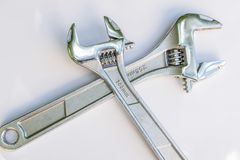 Two wrenches criscrossed royalty free stock image