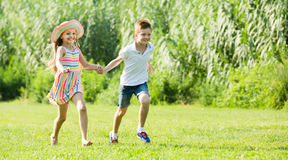 Two admiring children active playing and running outdoors Royalty Free Stock Photography