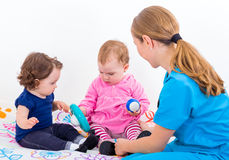 Two adorable baby at the doctor Stock Photos
