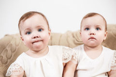 Two adorable baby twin girls. Stock Images