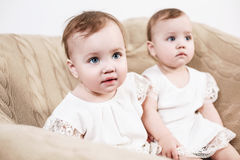 Two adorable baby twin girls. Royalty Free Stock Image