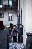 Two adorable boy, dressed in vintage style in the city center Stock Photos