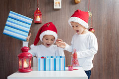 Two adorable boys, opening presents Royalty Free Stock Photo