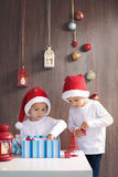 Two adorable boys, opening presents. On Christmas Royalty Free Stock Photo