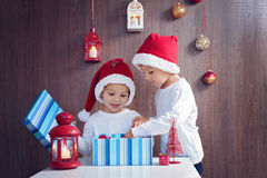 Two adorable boys, opening presents on Christmas. At home Royalty Free Stock Images