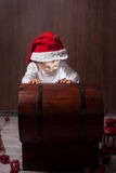 Two adorable boys, opening wooden chest, glowing light  Stock Photos