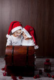 Two adorable boys, opening wooden chest,  Stock Images
