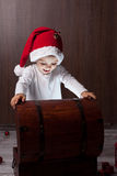 Two adorable boys, opening wooden chest    Stock Photo